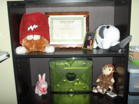 Xbox guarded by Bun-Bun, Ryo-Ohki wearing the Fez of Gaming Power, the Monty Python bunny, and Lain...I have nothing to fear.