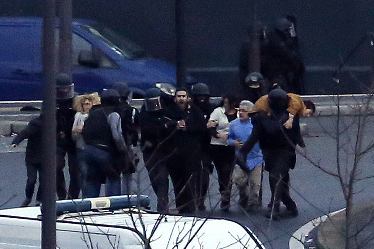 Members of the French police evacuate hostages after launching the assault at a kosher grocery store in Porte de Vincennes, eastern Paris, on Friday. At least two people were shot dead at the Jewish supermarket where five people were being held.