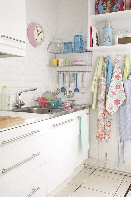 love this! I want a vintage pastel apron..... and a pink clock!
