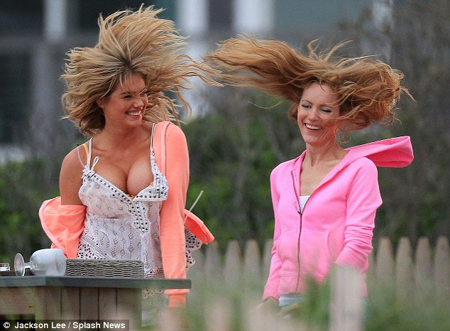 Messy hair, don't care: The pair's tresses got in a state as they got active