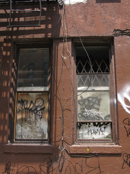 graffiti on a building and two windows, Manhattan, NYC