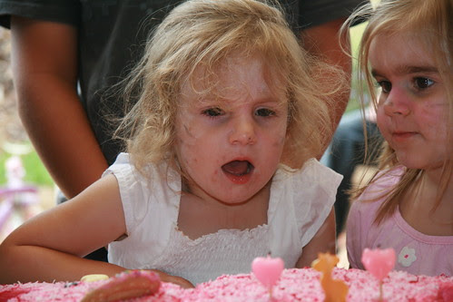 Chloe blows out her candles