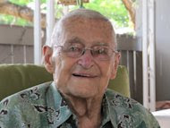 In this photo taken May 31, 2012, retired Rear Adm. Mac Showers, the last surviving member of the intelligence team that deciphered Japanese messages in the lead up to the Battle of Midway, is seen in Pearl Harbor, Hawaii. Showers and Navy officials are observing the 70th anniversary of the battle that changed the course of World War II on Monday, June 4, 2012. (AP Photo/Audrey McAvoy)