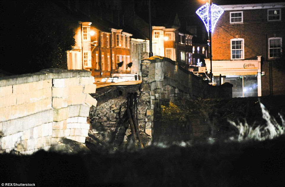 Falling in: Part of the ancient bridge in the centre of Tadcaster, North Yorkshire, has collapsed into the River Wharf