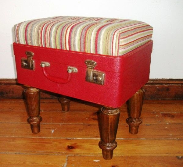 Padded suitcase on furniture legs