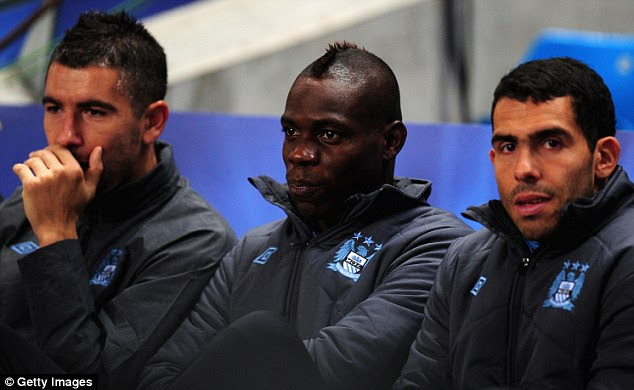 Speaking to Juve: Kolarov has been pushed down the order at Man City and could join Tevez (below, right) in Italy
