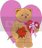 Romantic bear with hearts and flowers in this free valentine's day clipart image.