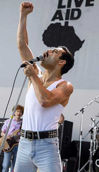 Freddie Mercury performs in 1985's Live Aid concert at the end of BOHEMIAN RHAPSODY.
