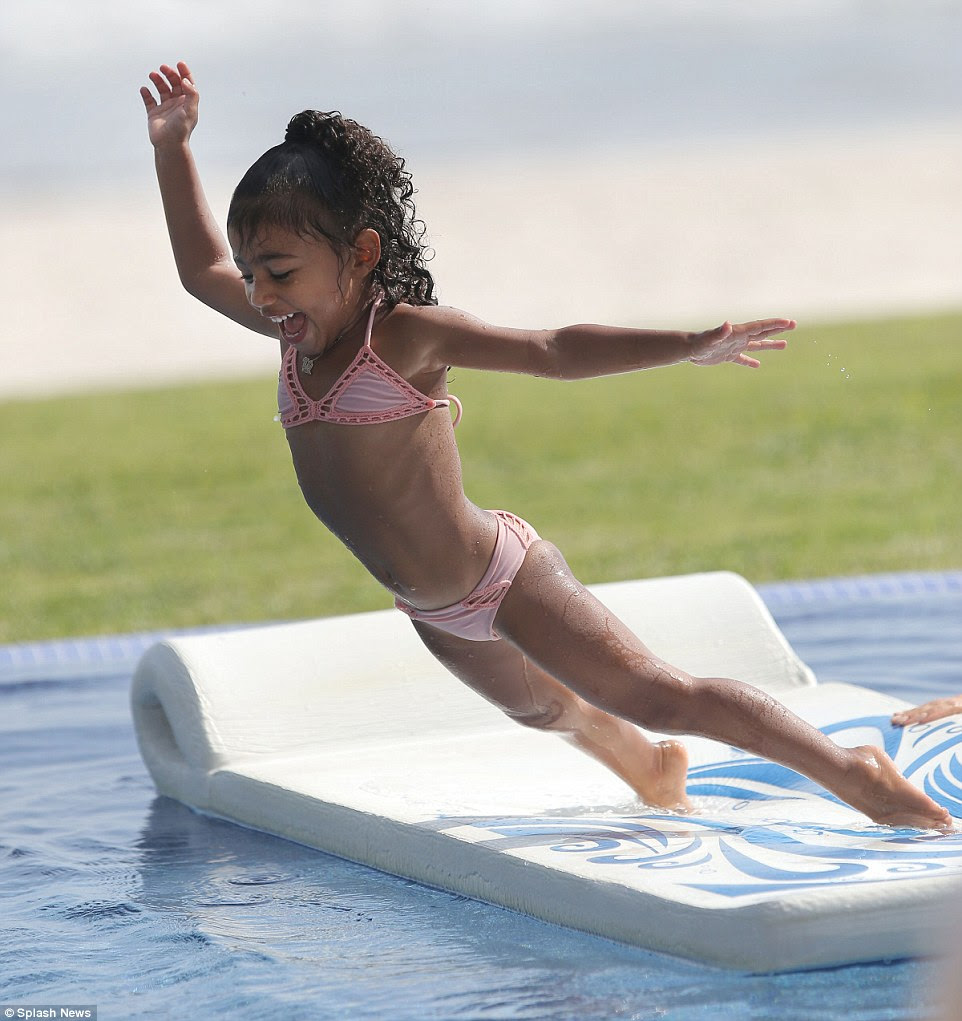 Jumping for joy! North was in her element as she took a dive into the water