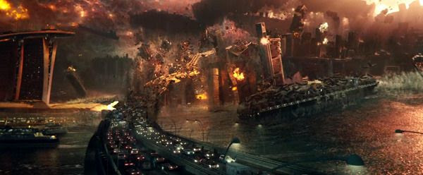Another crowd of people run away as a bridge they're on is torn apart by the anti-gravity device being used by an alien spacecraft hovering overhead in INDEPENDENCE DAY: RESURGENCE.