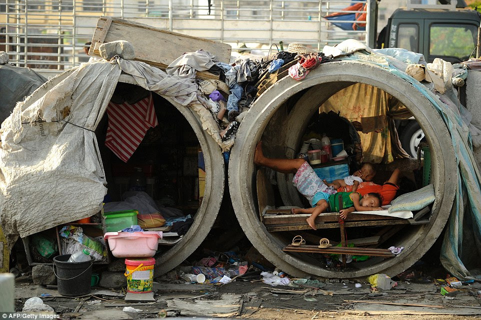 Many of the Philippines' desperate citizens dwell in whatever makeshift shelters they can find in the slums in Manila, including concrete pipes