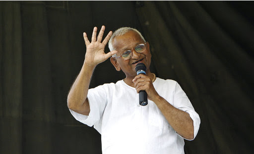 India's anti-corruption activist Anna Hazare speaks to the crowd during his hunger strike in New Delhi, India, Thursday, Aug. 25, 2011. Prime Minister Manmohan Singh seized control of a national anti-corruption debate Thursday, calling on Parliament to discuss protesters' reform proposals and appealing to the weakening 74-year-old activist to end his hunger strike. (AP Photo/Gurinder Osan)