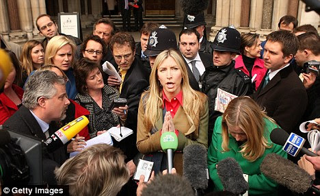 Media target: Heather, pictured speaking outside court after her divorce hearing, compared herself to Princess Diana