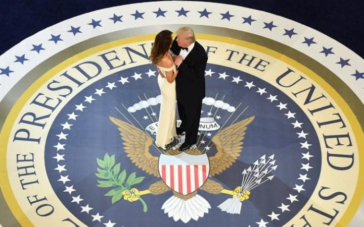 US President DonaldTrump (R) dances with First Lady Melanie Trumpwhile attending the Commander in Chief's Ball in Washington