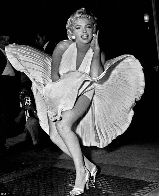 Immortalised: The movie icon striking her famous pose during the filming of The Seven Year Itch in 1954