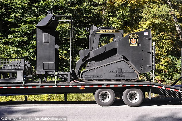 Awesome: The Rook, above, was seen being delivered today to authorities on the 11th day of the hunt for Frein
