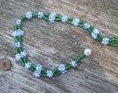 Beadwork flower chain bracelet.
