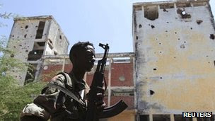 A Somali government soldier patrols the streets of capital Mogadishu 22 February 2012