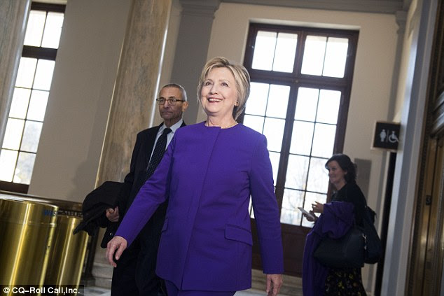 Hacking that Obama blames on Putin plumbed computers linked with Hillary Clinton and the Democratic National Committee, and plundered emails belonging to Clinton campaign chairman John Podesta (background, center)