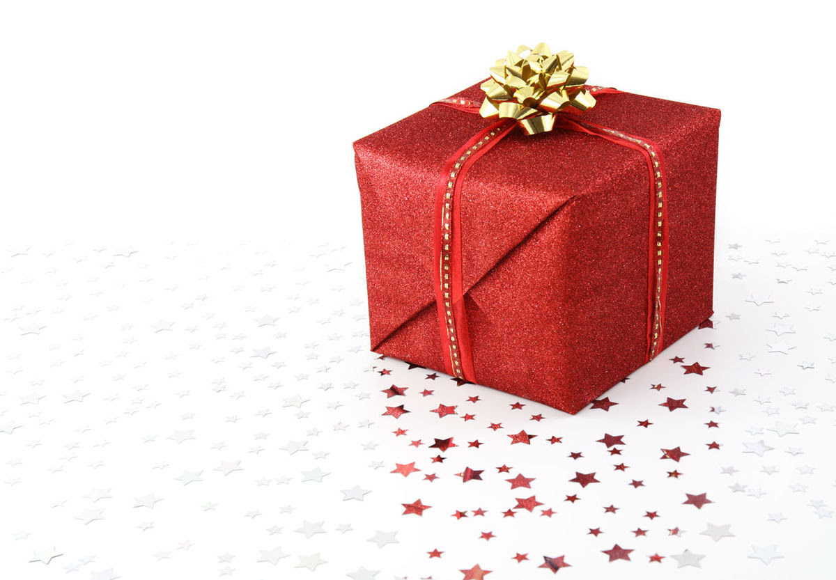 Red Christmas present on white background.jpg