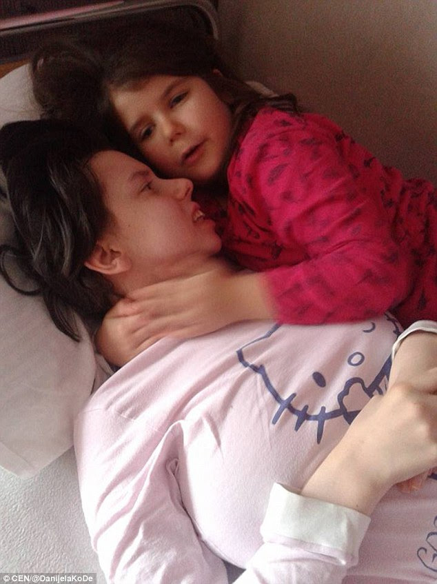 Together: Danijela Kovacevic, 25, recently emerged from her vegetative state to meet her daughter Marija, who is now seven years old