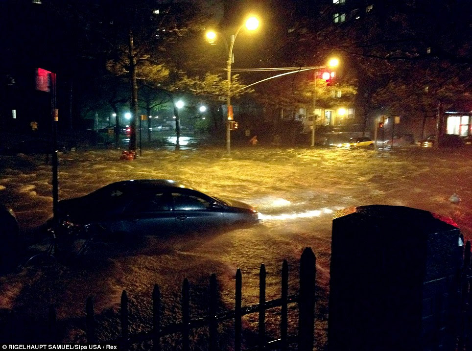 Underwater: The surge from New York's East River has flooded East 20th Street, turning the road into a river