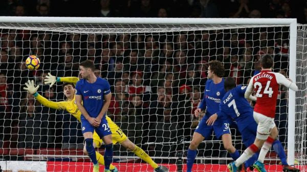 •Bellerin (R) whips the ball past Chelsea defenders and goalkeeper Courtois last night at the Emir
