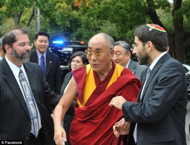 Leader: Steinlauf, pictured right with the Dalai Lama, has been praised with bringing traditional and progressive Jews together. In 2012, he officiated his synagogue's first same-sex marriage