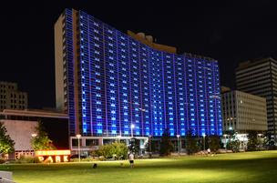 The Statler Hilton Hotel building is now illuminated by blue lights.