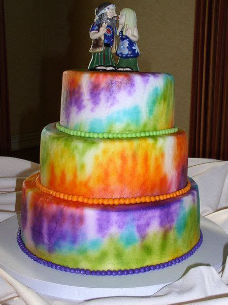 A tie dye wedding cake for this whimsical wedding. Cakes
