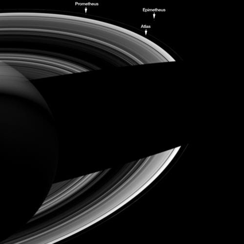 Saturn, its rings and three moons are visible in this image from Cassini. Credit: NASA/ESA