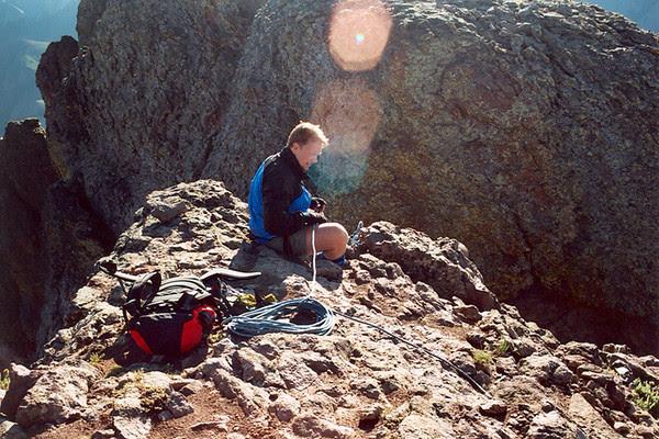 Preparing to rappel into Coxcomb's summit ridge cleft