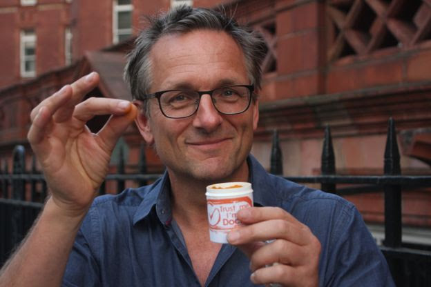 Michael Mosley holding a pinch of turmeric