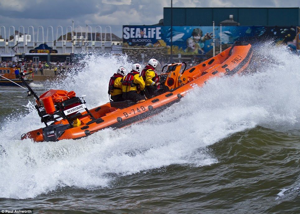 Undaunted: Paul Ashworth who is based in Fleetword captured a lifeboat tilting at 45 degrees as it powered through rough seas in Blackpool