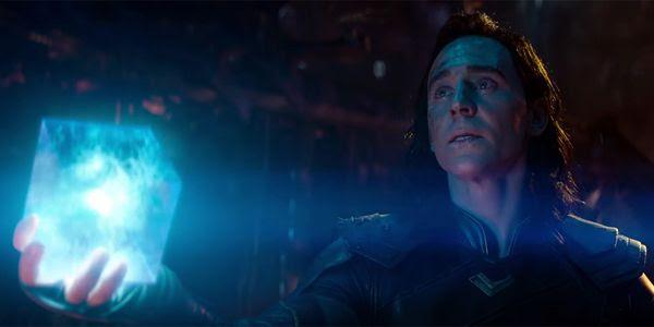 Tom Hiddleston's Loki holds the Tesseract in AVENGERS: INFINITY WAR.