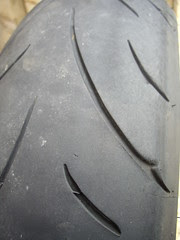 old tire at the wear bars, but tread left on the edges