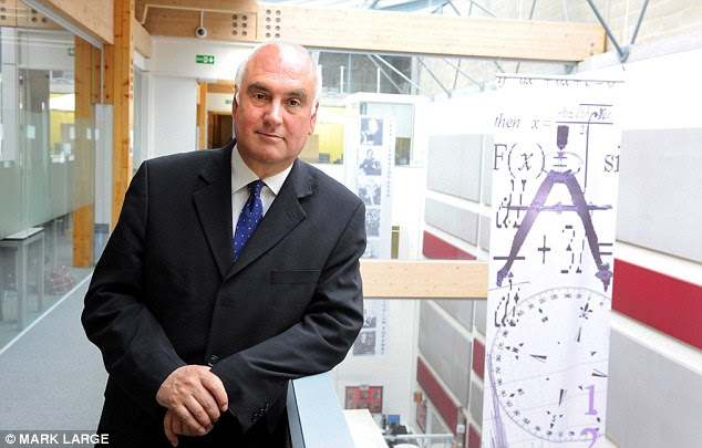 Tackling disruption: New Ofsted chief Sir Michael Wilshaw, pictured at Mossbourne Academy in east London, where, as head, he banned mobile phones. He believes such measures should be rolled out across the country