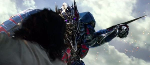 Optimus Prime prepares to lunge at Bumblebee with his energon blade in TRANSFORMERS: THE LAST KNIGHT.