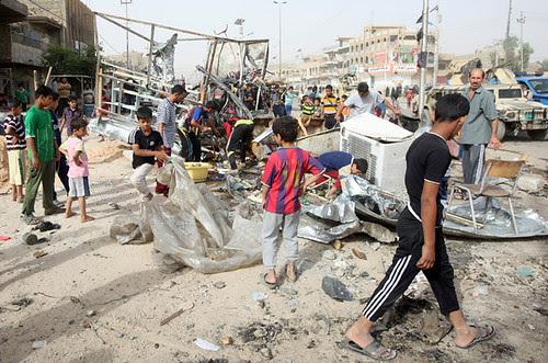 Children at the scene of a bombing in Sadr City, Iraq on May 23, 2011. The war inside Iraq has escalated since the beginning of the year. by Pan-African News Wire File Photos