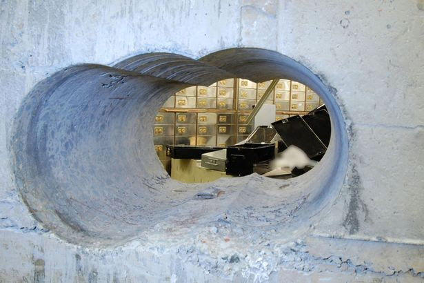 The tunnel leading into the vault at the Hatton Garden Safe Deposit company which was robbed over the Easter weekend, as seven men have been arrested in connection with the jewellery raid