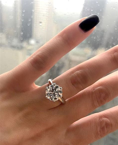 13 Solitaire Diamond Engagement Rings on Different Hands