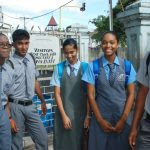 Being early to school, these youths were more than happy to pose for a photo for the Guyana Chronicle.