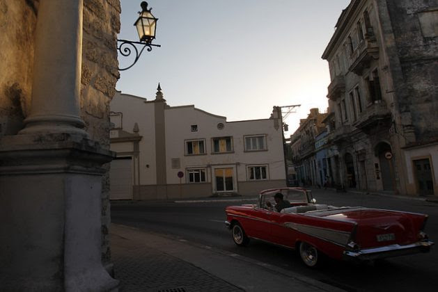 A classic 1957 convertible Chevrolet Bel-Air, used by private drivers for sightseeing tours, drives through the historic centre of Old Havana in search of customers, now that the boom of visits by U.S. citizens has ceased. Credit: Jorge Luis Baños / IPS