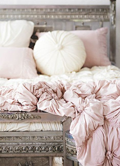 silver/gray bed with pale pink bedding