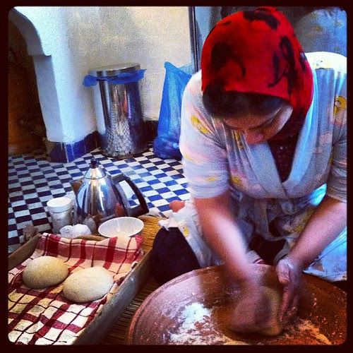 Bread making!!!! Another HUGE Moroccan breakfast! Different breads baked & fried, jams, tagine of eggs, tea, coffee, yogurt, etc etc etc.  #morocco #travel #tripofalifetime #fes #fez #bread #breadmaking by sarahdabearah