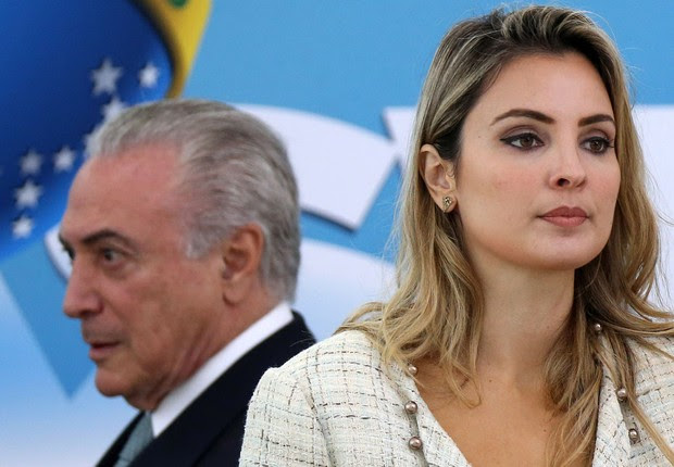 O presidente Michel Temer e a primeira-dama Marcela Temer em cerimônia com oficiais militares (Foto: Adriano Machado/Reuters)