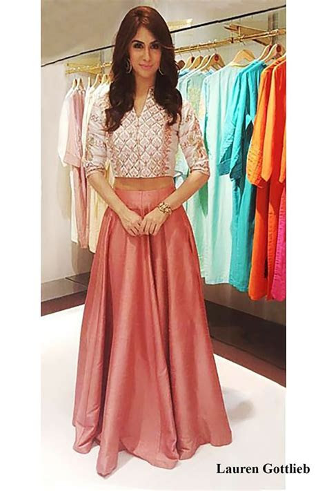 Featuring a crop top and skirt in shades of blush. To wear
