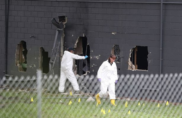FBI agents investigate near the damaged rear wall of the Pulse Nightclub where Omar Mateen allegedly killed at least 50 people