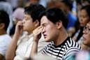 Tearful relatives of Indonesia jet crash victims demand answers