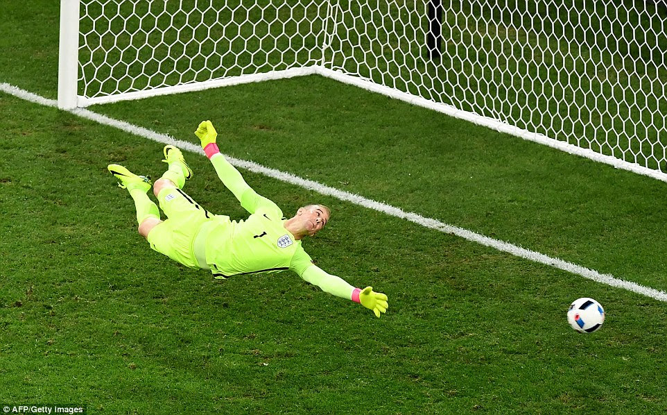 England and Manchester City goalkeeper Hart dives low to his left and is grateful to see the Russian shot flash past the post